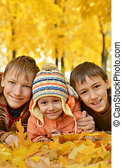 Boys and a girl on take a walk during the fall of the leaves...