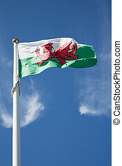 Welsh flag on a blue sky background