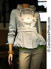 Dummy - Doll in a gray jacket and pants in the window