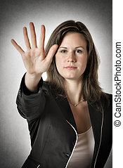 Business woman hand stop - Business woman in black suit...