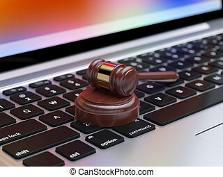 Online internet auction - Gavel on laptop with soft focus....