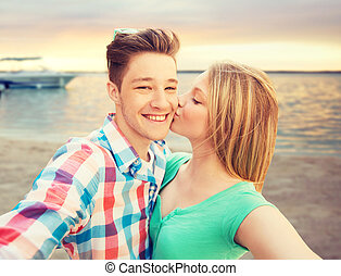 happy couple taking selfie on summer beach - travel,...