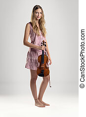 Pretty barefoot young woman with a violin