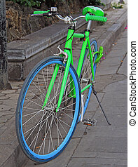 bright lettuce green bicycle on the street in Lijiang