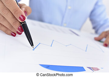 businesswoman with a chart with an upward trend - closeup of...