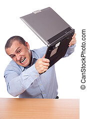 Angry businessman at laptop - Angry businessman smashing his...