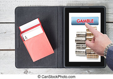 Online gambling, technology with mobile tablet on a wooden table