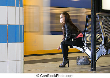 Waiting woman at train station - Woman, sitting on a bench,...