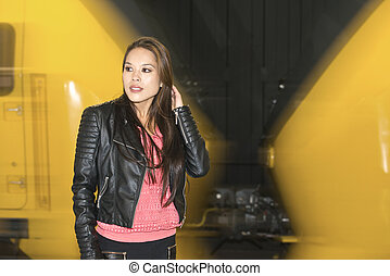 Woman in front of a passing train - Woman standing in front...