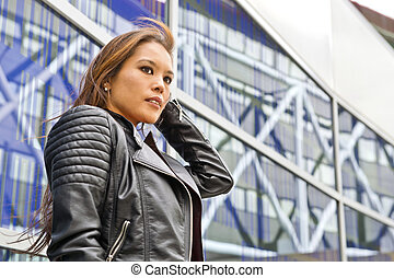 Urban worldly woman - Worldly Asian woman, wearing a leather...