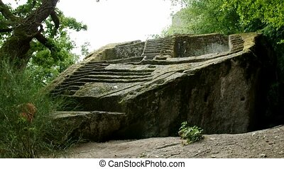 Etruscan Pyramid Explorer - man climbing the ancient...
