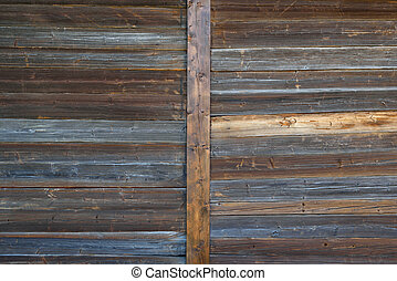 Dark brown and weathered wooden gate texture