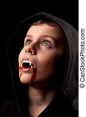 Little vampire - 8 years old boy dressed as a vampire with...