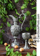 Antique pewter - Antique pitcher and a goblet as well as...