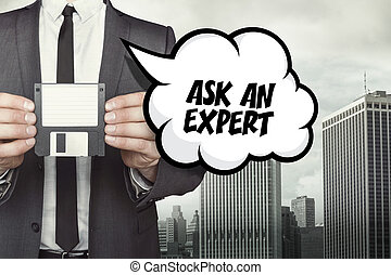 Ask an expert text on speech bubble with businessman holding...