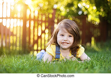 Cute litte girl - Cute little girl with chocolate face lying...