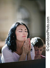 Woman with her son praying - Beautiful woman with her son...