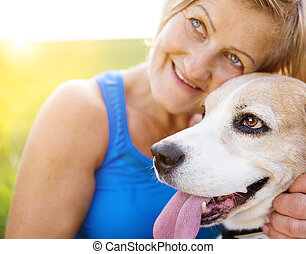 Woman with a dog - Active senior woman with her dog on a run...