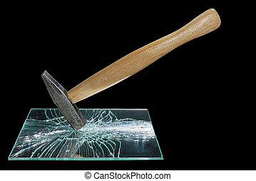Hammer smashed a mirror on a black background