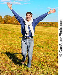 Happy Young Man outdoor - Cheerful Teenager run in the...