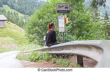 LENK, SWITZERLAND - JULY 23, 2015: Young woman checking the...