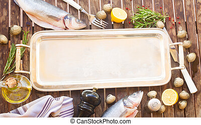 Seabass - Empty silver tray with frame of seabass fish,...