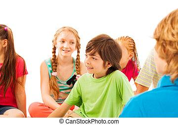 Nice looking boy in circle of friends - Nice school age boy...