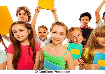 Cute funny group portrait of school kids