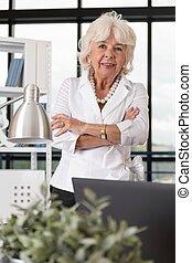 Glad elder businesswoman - Elder businesswoman is glad...