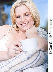 single woman - beautiful blonde single woman lazing on sofa...