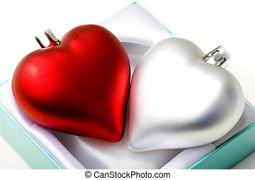 Pair of decoration hearts in a gift box emotional love...