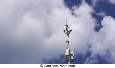 Communications antenna in high cloudy sky