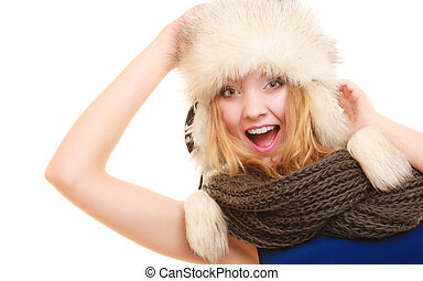 Winter fashion. Happy young woman in fur hat.