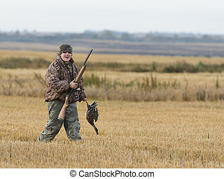 Duck Hunting - A young duck hunter on a nice autumn day