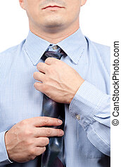 Businessman adjusting tie knot - Handsome businessman...