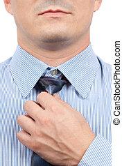 Businessman adjusting tie knot - Handsome businessman...