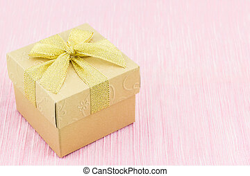 Golden gift box with ribbon bow