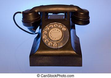 Black retro phone - black retro phone studio shot blue...
