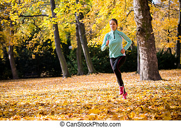 Woman jogging in nature - Young woman jogging and training...