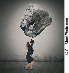 Support a big weight - Businesswoman holding up a big rock...