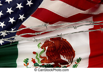 US and Mexican flags separated by barbed wire - Close-up...