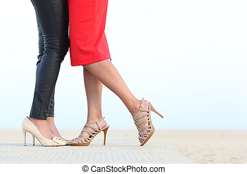 Couple of lesbian women legs cuddling with love - Side view...