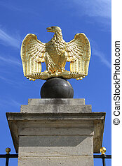 eagle - Eagle gilded gold statue placed on a column