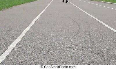 Teenager running on stadium