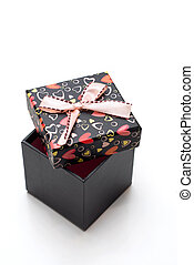 opened black gift box with hearts shape in white background