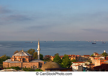 ships in the Sea of Marmara and a mosque at sunrise,...