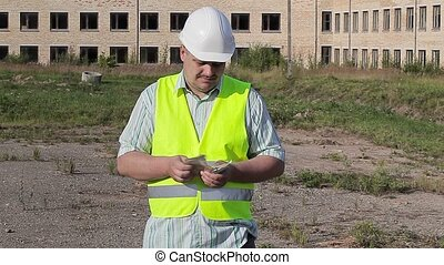 Construction worker to count money