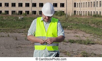Happy construction worker with money