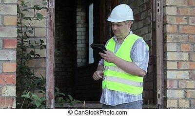 Building inspector check broken door