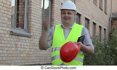 Building inspector with helmet for worker